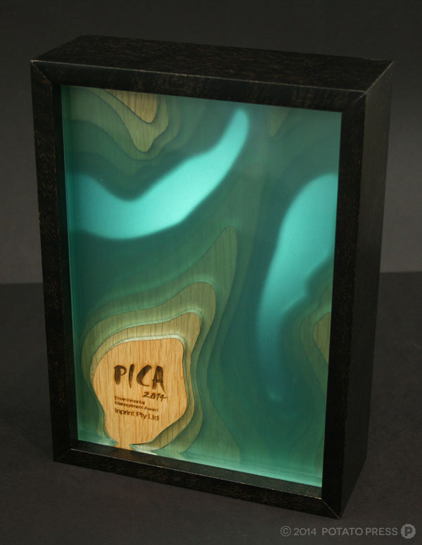pica-awards-in-backlit-tall-placement-wood-pica-potatopress-australia-brisbane-goldcoast-international-australiawide-custom-trophy-joinery-timber-acrylic-custom